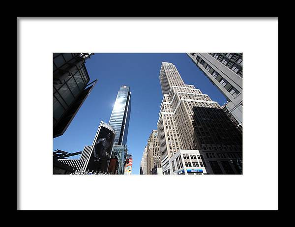 Skyscrapers Framed Print featuring the photograph Sky High by Mary Haber