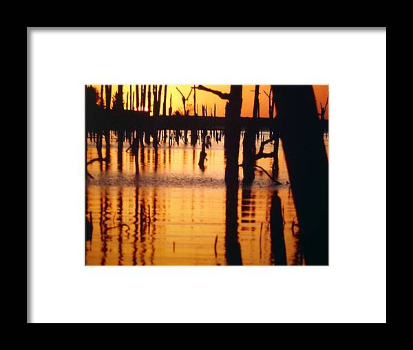 Water Framed Print featuring the pyrography Slue Sunset by Myrna Salaun