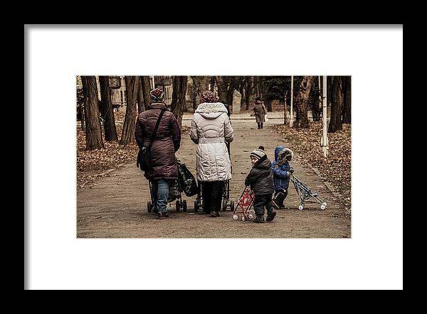 Odessa Framed Print featuring the photograph Small Child Looking Backward by Reksik004