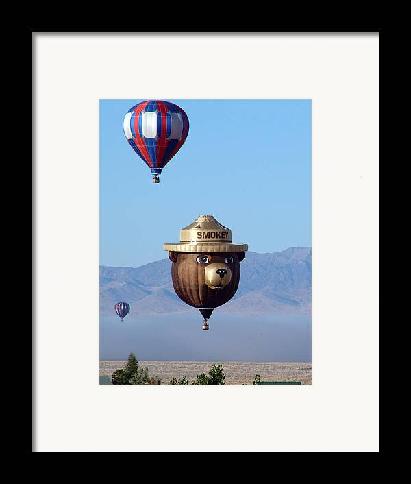 Smokey Framed Print featuring the photograph Smokey Flies by Charles Ridgway