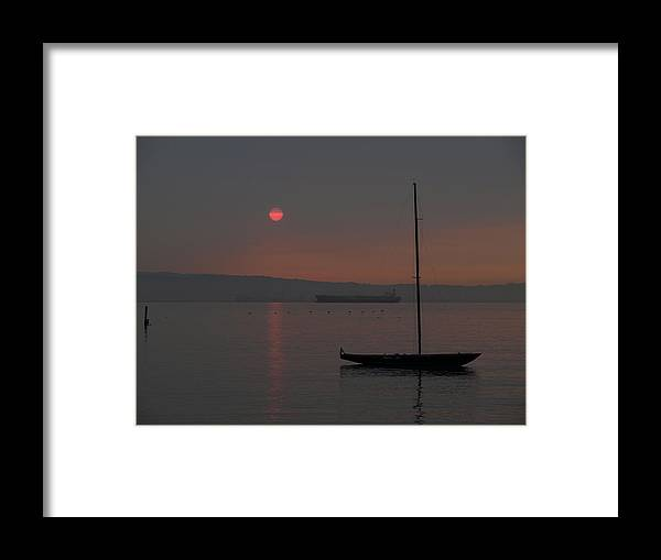 Sea Framed Print featuring the photograph Smoky Sunrise by Laura Allenby