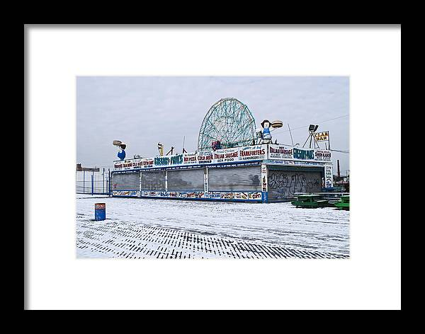 Coney Island Framed Print featuring the photograph Snowy Coney Island by Andrew Kazmierski