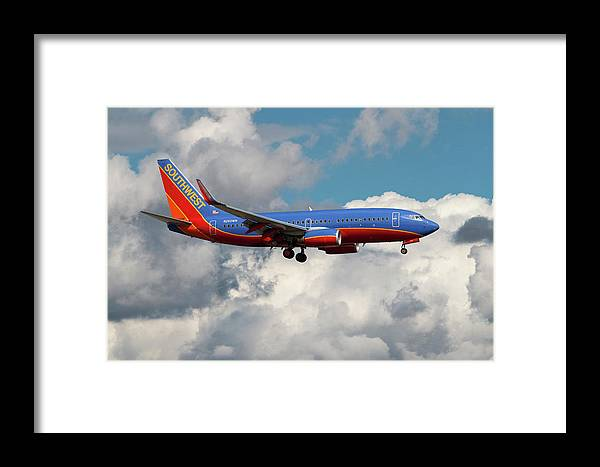 Southwest Airlines Framed Print featuring the photograph Southwest Airlines Boeing 737-700 by Erik Simonsen