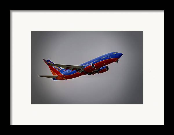 737 Framed Print featuring the photograph Southwest Departure by Ricky Barnard