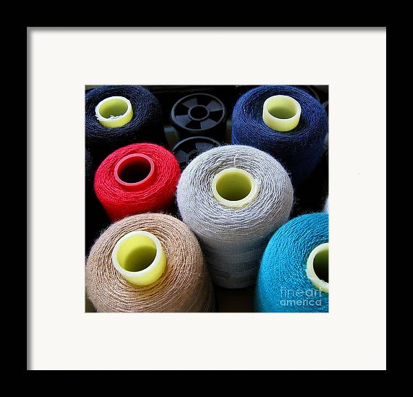 Yarn Framed Print featuring the photograph Spools Of Yarn by Yali Shi