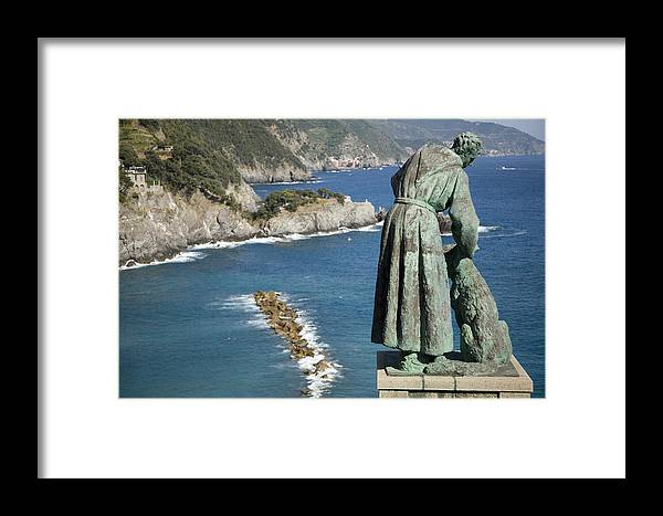 Travel Framed Print featuring the photograph Statue Of Saint Francis Of Assisi Petting A Dog by Ian Middleton