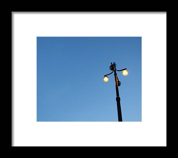 Sky Framed Print featuring the photograph Stockholm Street Lamp by Linda Woods