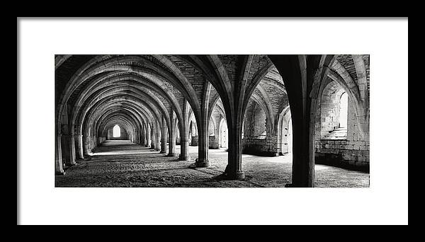 Fountains Abbey Framed Print featuring the photograph Stone Arches by Michael Hudson