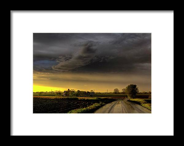 Storm Framed Print featuring the photograph Storm Before Sunset by Seth Dochter