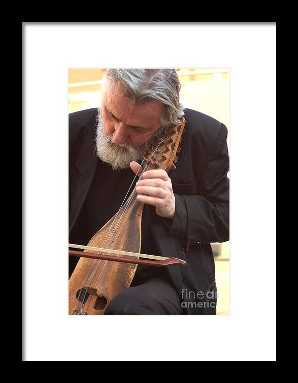 Venice Framed Print featuring the photograph Street Musician In Venice by Michael Henderson