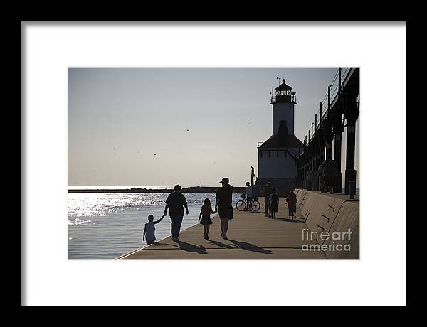 Lighthouse Framed Print featuring the photograph Stroll by Jeannie Burleson