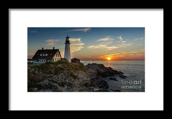 Lighthouse Framed Print featuring the photograph Sun Rising At Portland Head Light by Jerry Fornarotto