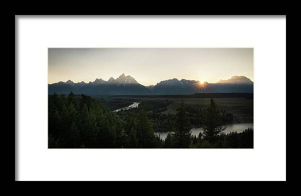 Grand Tetons Framed Print featuring the photograph Sun Setting Over The Teton Range by James Udall