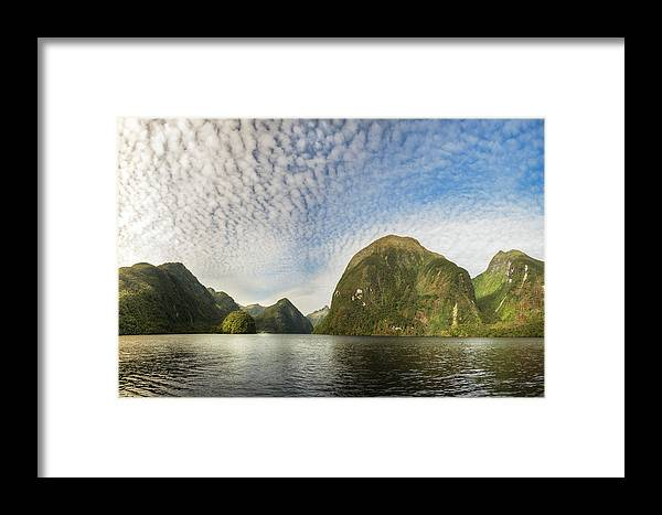 Doubtful Sound Framed Print featuring the photograph Sunglow In Middle Earth Fantasy-land by Daniela Constantinescu