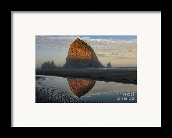 Waterscapes Framed Print featuring the photograph Sunrise On Haystack Rock - Oregon by Sandra Bronstein