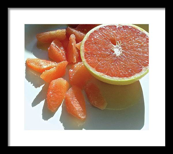 Grapefruit Framed Print featuring the photograph Sunrise Sections by James Temple