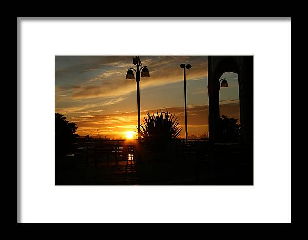 Sunset Framed Print featuring the photograph Sunset On The Dock by Joshua Sunday