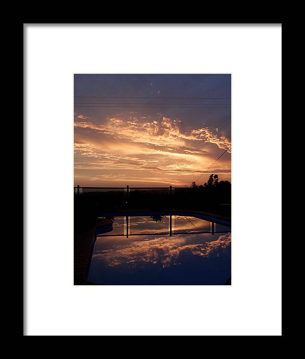 Pool Framed Print featuring the photograph Sunset Over A Pool by Edan Chapman