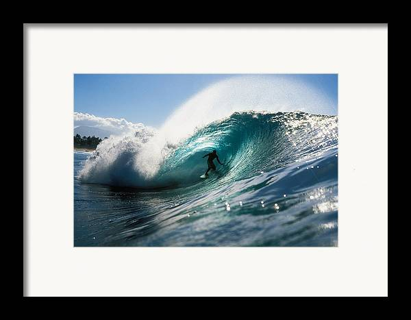 Adrenaline Framed Print featuring the photograph Surfer At Pipeline by Vince Cavataio - Printscapes