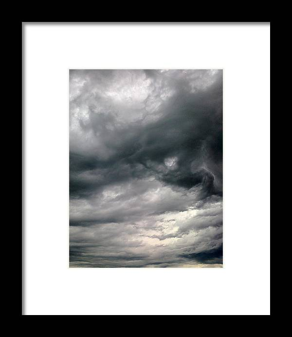 Clouds Framed Print featuring the photograph Swirling Clouds by Stephen Doughten