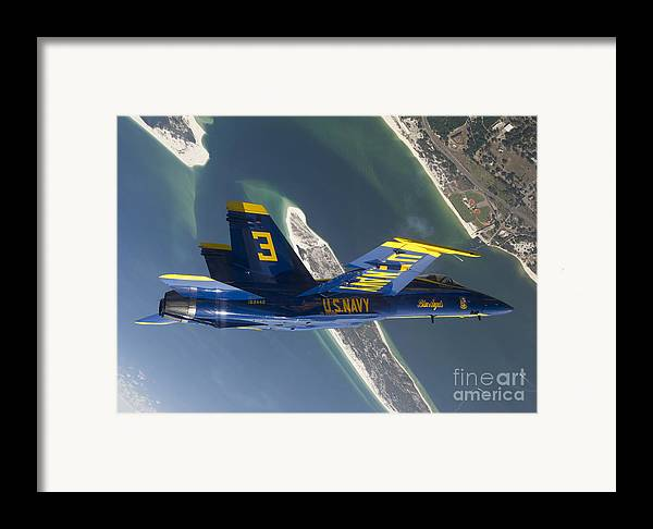 Blue Angels Framed Print featuring the photograph The Blue Angels Perform A Looping by Stocktrek Images