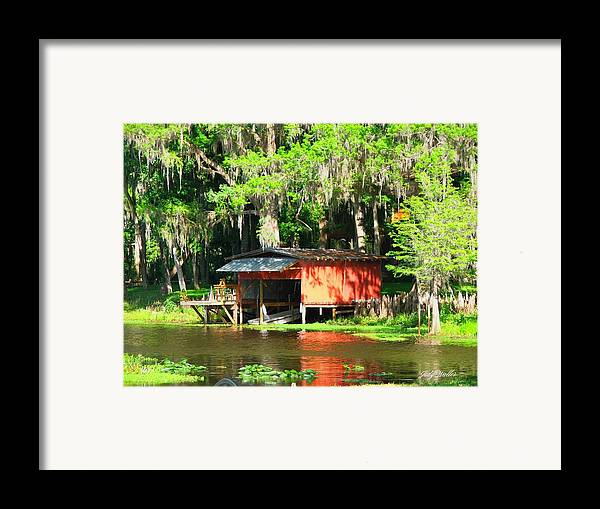 Boathouse Framed Print featuring the photograph The Boat House by Judy Waller
