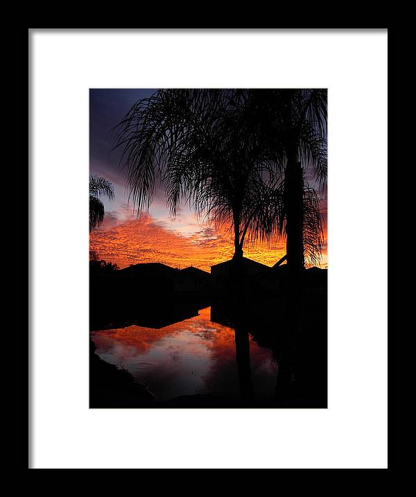 Sunsets Framed Print featuring the photograph The Devil's Reflection by Amanda Vouglas
