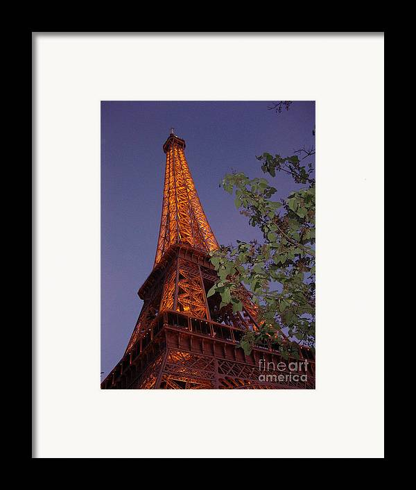 Tower Framed Print featuring the photograph The Eiffel Tower Aglow by Nadine Rippelmeyer