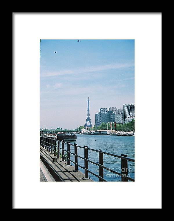 The Eiffel Tower Framed Print featuring the photograph The Eiffel Tower And The Seine River by Nadine Rippelmeyer