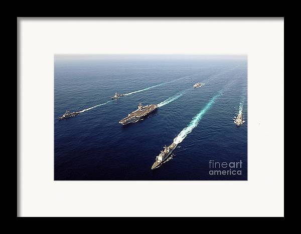 Uss Enterprise Framed Print featuring the photograph The Enterprise Carrier Strike Group by Stocktrek Images