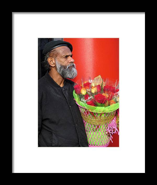Flower Framed Print featuring the photograph The Flower Vendor - Man Selling Roses by De Ann Troen