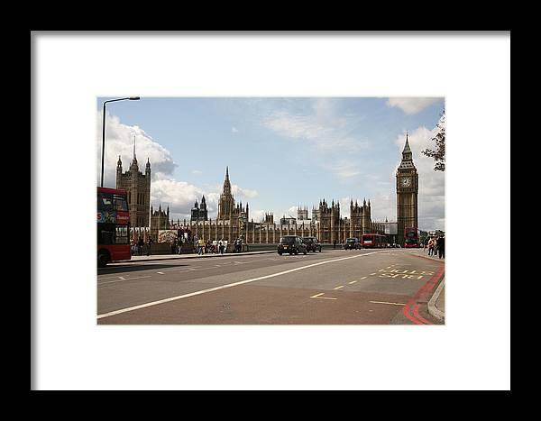 Busses Framed Print featuring the photograph The Houses Of Parliament. by Christopher Rowlands