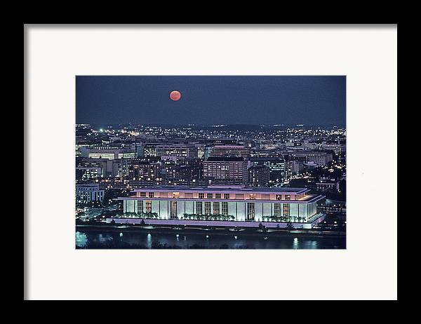 Kennedy Center Framed Print featuring the photograph The Kennedy Center Lit Up At Night by Kenneth Garrett