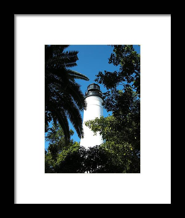 Lighthouse Framed Print featuring the photograph The Lighthouse by Audrey Venute
