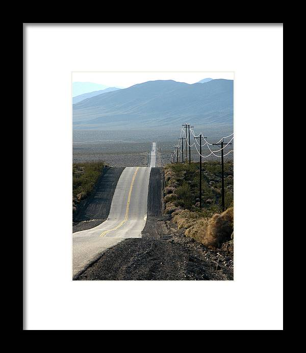 Highway Framed Print featuring the photograph The Long And Winding Road by Helaine Cummins