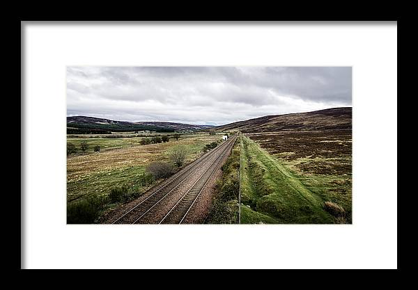 Rail Framed Print featuring the photograph The Railroad To....in Scotland With Clouds Hanging Over The Mountains. by Ineke Mighorst