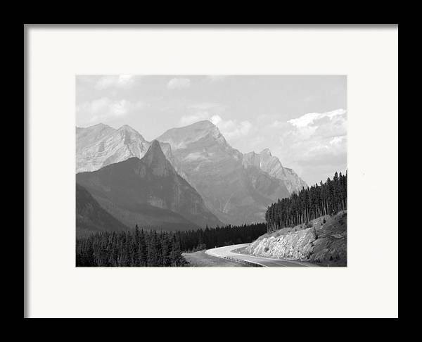 Landscape Framed Print featuring the photograph The Road Less Travelled by Tiffany Vest