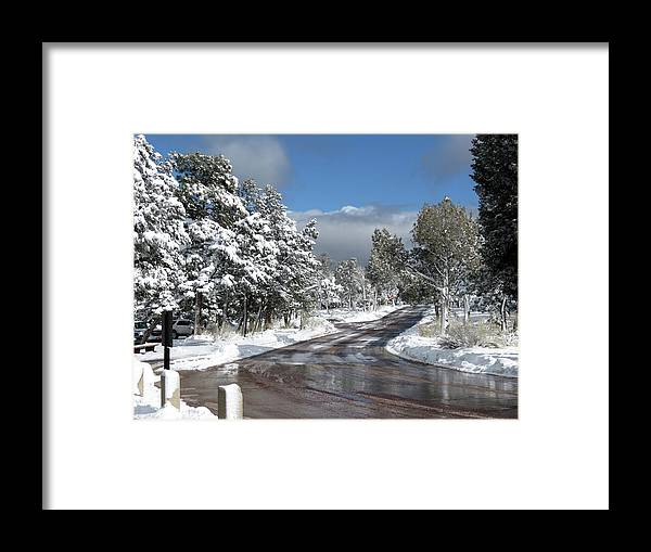 Road Framed Print featuring the photograph The Road Through Winter by Laurel Powell