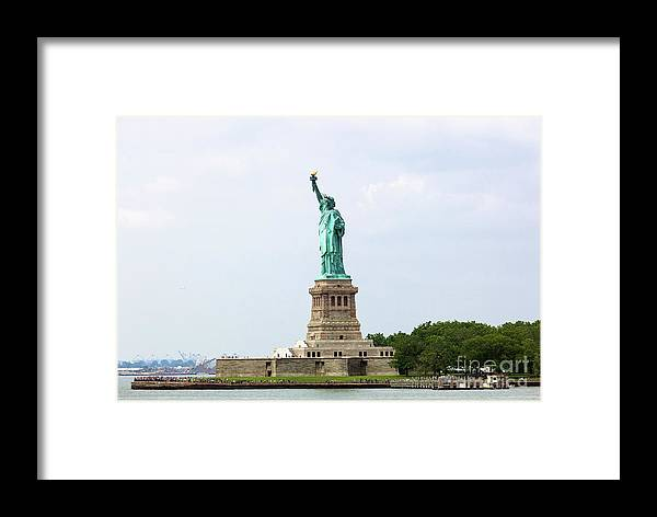 Tourism Framed Print featuring the photograph The Statue Of Liberty In New York City by Antonio Gravante
