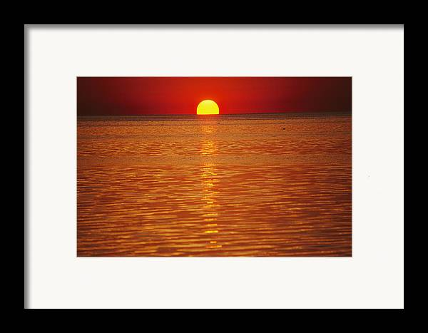 Atlantic Ocean Framed Print featuring the photograph The Sun Sinks Into Pamlico Sound Seen by Stephen St. John
