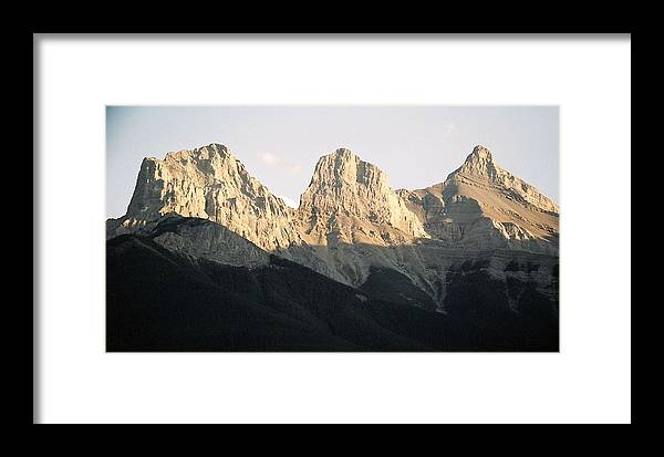 Rocky Mountains Framed Print featuring the photograph The Three Sisters Of The Rockies by Tiffany Vest
