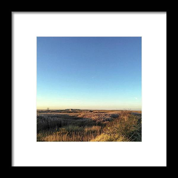 Natureonly Framed Print featuring the photograph Thornham Marsh Lit By The Setting Sun by John Edwards