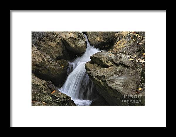Water Framed Print featuring the photograph Through The Rocks by Deborah Benoit