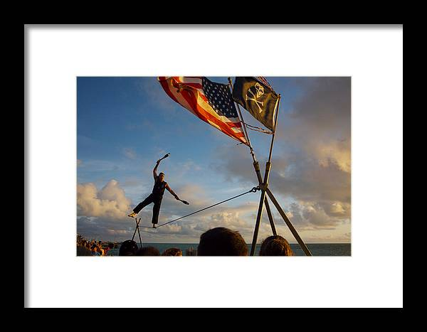 Balance Framed Print featuring the photograph Tight Rope Walker In Key West by Carl Purcell