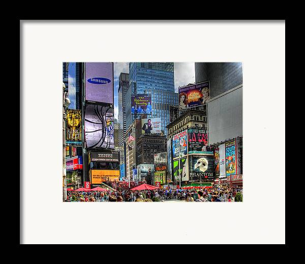 In Focus Framed Print featuring the photograph Times Square by Joe Paniccia