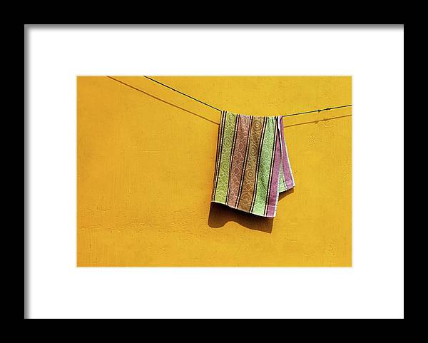 Minimalism Framed Print featuring the photograph Towel drying on a Clothesline in India by Prakash Ghai