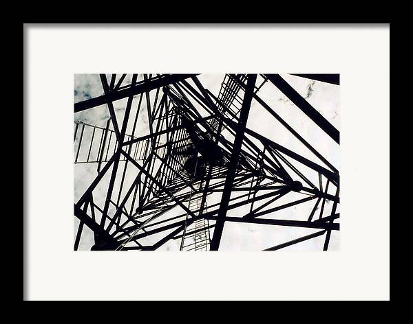 Rust Framed Print featuring the photograph Tower Grid by Margaret Fortunato
