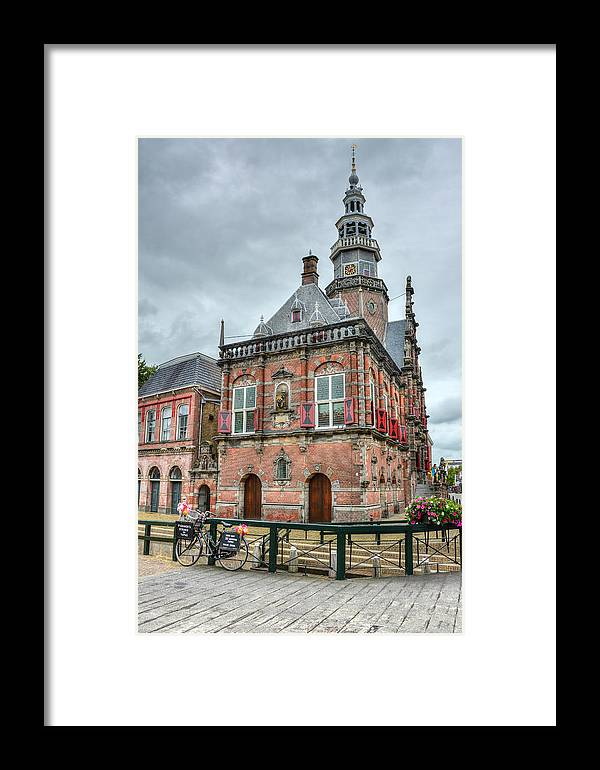 Bolsward Framed Print featuring the photograph Town Hall by Joan Baker
