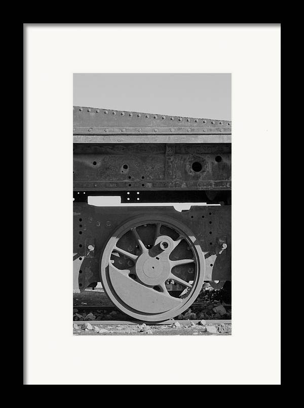 Train Framed Print featuring the photograph Train Wheel by Marcus Best