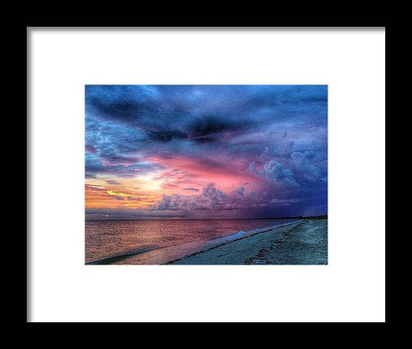 Troubling Skies Framed Print featuring the photograph Troubling Skies by Charles J Pfohl